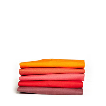 small-pile-of-t-shirts